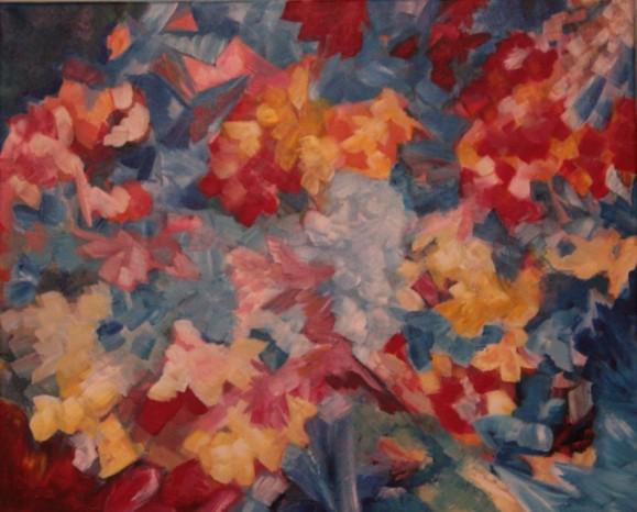 Abstrakti maalaus. Laikukasta maalausjälkeä: punaisen, sinisen ja keltaisen sävyjä.